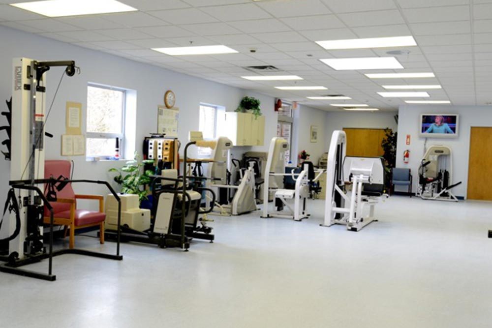 Exercise room full of physical therapy equipment at Carillon.